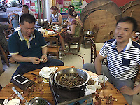 People enjoy dog meat at the Yulin Dog Meat Festival kicks off, Yulin, Guangxi Province, China, 21 June 2016.
