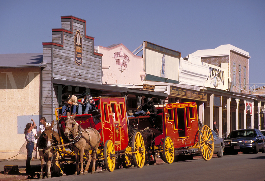 Sightseeing stage coaches awaiting passengers on Allen St. in the business district of Tombstone, AZ. Tombstone Arizona USA.