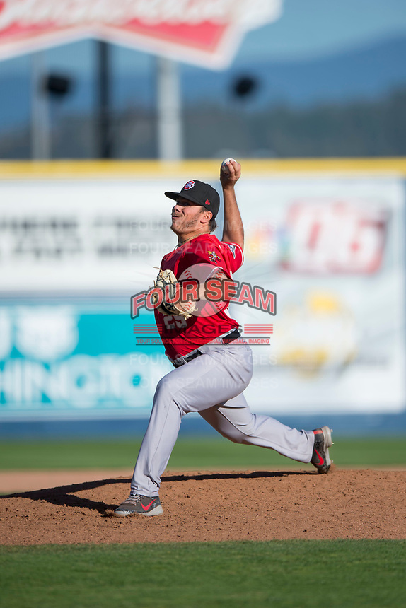Vancouver Canadians relief pitcher Justin Watts (25) delivers a pitch during a Northwest League game against the Spokane Indians at Avista Stadium on September 2, 2018 in Spokane, Washington. The Spokane Indians defeated the Vancouver Canadians by a score of 3-1. (Zachary Lucy/Four Seam Images)