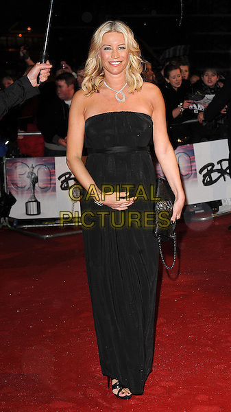 DENISE VAN OUTEN.Arrivals the Brit Awards 2010 held at Earls Court, London, England..February 16th 2010 .Brits full length strapless black dress maxi hand on bump clutch bag pregnant maternity .CAP/BEL.©Tom Belcher/Capital Pictures.