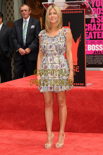 Jennifer Aniston.The Jennifer Aniston Hand and Footprints Ceremony held at The Grauman's Chinese Theatre in Hollywood, California, USA..July 7th, 2011.full length white grey gray purple floral print dress beige peep toe shoes  .CAP/ADM/BP.©Byron Purvis/AdMedia/Capital Pictures.