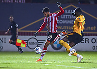 Lincoln City's Matt Green vies for possession with  Wolverhampton Wanderers U21's Dominic Iorfa<br /> <br /> Photographer Andrew Vaughan/CameraSport<br /> <br /> The EFL Checkatrade Trophy Northern Group H - Lincoln City v Wolverhampton Wanderers U21 - Tuesday 6th November 2018 - Sincil Bank - Lincoln<br />  <br /> World Copyright © 2018 CameraSport. All rights reserved. 43 Linden Ave. Countesthorpe. Leicester. England. LE8 5PG - Tel: +44 (0) 116 277 4147 - admin@camerasport.com - www.camerasport.com