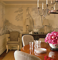 The dining room is furnished with a mahogany Charles X table and a marble-topped 18th century console table