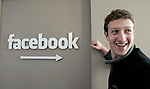 Facebook.com's mastermind Mark Zuckerberg smiles at his office in Palo Alto, Calif. in this Feb. 5, 2007 file photo.