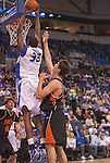 March 24,  2010                Saint Louis forward Willie Reed (33) takes the ball above the basket to slam dunk in the first half.  At right is Princeton center Pawel Buczak (55).    The Saint Louis University Billikens hosted the Princeton Tigers in a semifinal game of the College Basketball Invitational Tournament on Wednesday March 24, 2010 at the Chaifetz Arena, on the campus of Saint Louis University.