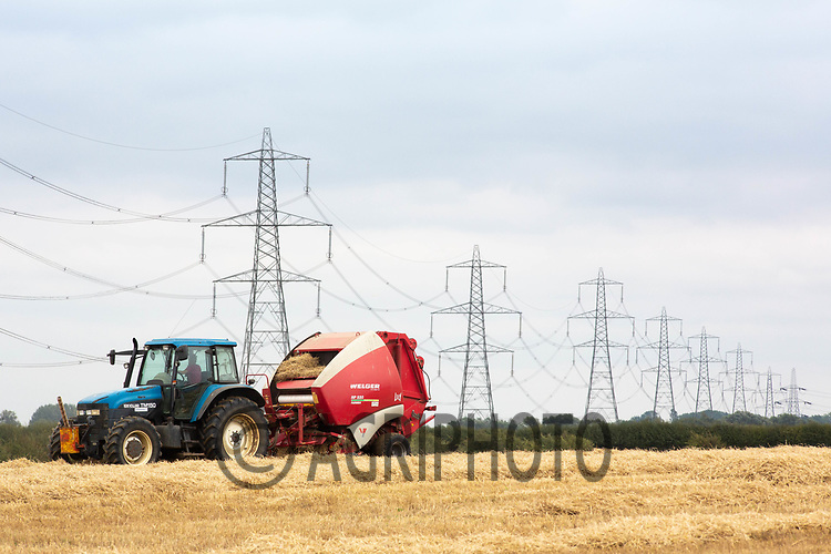 7.9.2020 Tractor and baler working in a field with power lines <br /> ©Tim Scrivener Photographer 07850 303986<br />      ....Covering Agriculture In The UK.