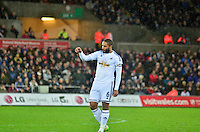Pictured: Friday 26 December 2014<br /> Re: Premier League, Swansea City FC v Aston Villa at the Liberty Stadium, Swansea, south Wales, UK.<br /> <br /> Ashley Williams leaving the field