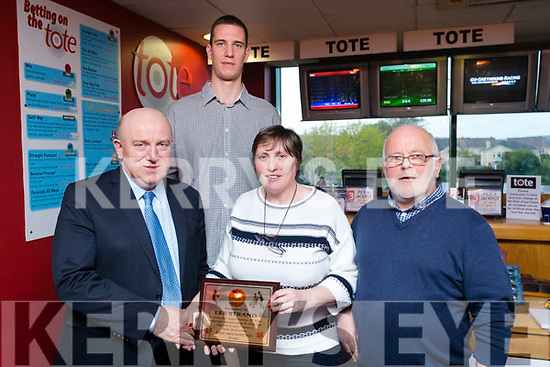 Jerry Dwyer (Lee Strand and main sponsor) who was presented with an appreciation award on Tuesday night last at the Kingdom Greyhound Stadium, Tralee, by Ann Scanlon (Vice Chairperson Kerry Area Basketball Board), Dusan Bogdanovic (Tralee Warriors) and Mchael Fleming (Chairman of Kerry Area Basketball Board).