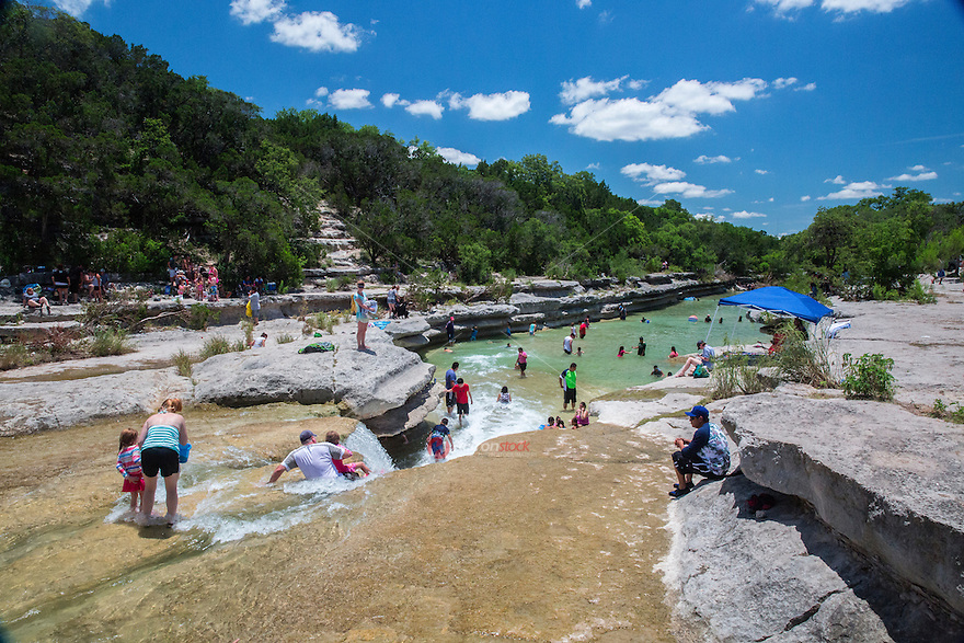 Swimmers flock to Bull Creek District Park, a favorite Austin swimming hole and provide the most tranquil water falls in west Austin.