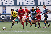 Scott Williams of Scarlets chases the loose ball during the Guinness Pro 14 match between Cardiff Blues and Scarlets at the Cardiff Arms Park, Wales, UK. Sunday 31 December 2017