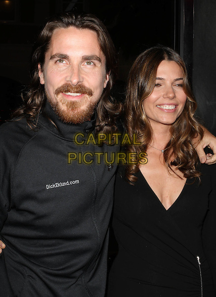 "CHRISTIAN BALE & SIBI BLAZIC .""The Fighter"" Los Angeles Premiere held At The Grauman's Chinese Theatre,  Hollywood, CA, 6th December 2010..half length married couple husband wife black dress wrap zip jacket beard facial hair .CAP/ADM/KB.©Kevan Brooks/AdMedia/Capital Pictures."