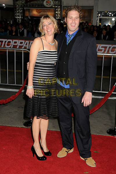 "GUEST & T.J. MILLER.""Unstoppable"" Los Angeles Premiere held at the Regency Village Theatre, Westwood, California, USA..October 26th, 2010.full length suit dress striped stripes black blue.CAP/ADM/BP.©Byron Purvis/AdMedia/Capital Pictures."