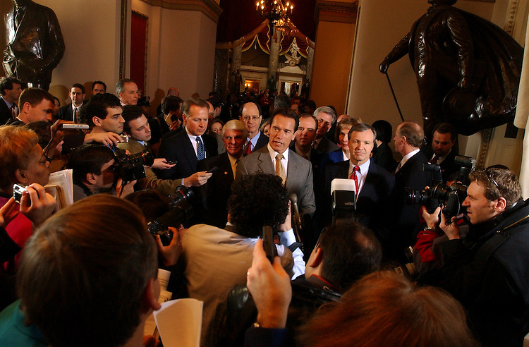 Gov. Arnold Schwarzenegger, R-Calif., addresses the press with  members of the California delegation, Thrusday, near Statuary Hall.