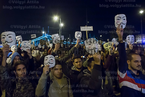 Participants attend a local event of the global Million masked march movement in central Budapest, Hungary on November 05, 2014. ATTILA VOLGYI