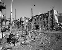 Grozny, Chechnya, March 1995..A Russian soldier sits in Palace Square in the ruined Chechen capital after rebel forces retreated from the city in the face of the Russian bombardment..