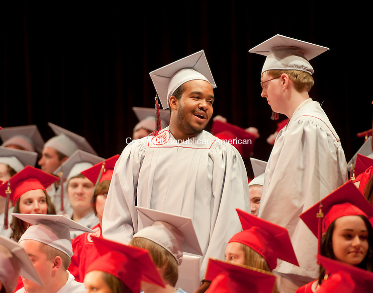 TORRINGTON, CT-061814JS12--Northwestern Regional High School graduate Phillips Garcia, left, chats with classmate Jonathan Gaspar after they received their diplomas during graduation ceremonies Wednesday at the Warner Theatre in Torrington. <br /> Jim Shannon Republican-American