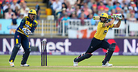 Glamorgan's Chris Cooke looks on as Birmingham Bears' Grant Elliott drives<br /> <br /> Photographer Andrew Kearns/CameraSport<br /> <br /> NatWest T20 Blast Semi-Final - Birmingham Bears v Glamorgan - Saturday 2nd September 2017 - Edgbaston, Birmingham<br /> <br /> World Copyright &copy; 2017 CameraSport. All rights reserved. 43 Linden Ave. Countesthorpe. Leicester. England. LE8 5PG - Tel: +44 (0) 116 277 4147 - admin@camerasport.com - www.camerasport.com