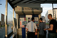 Buying jetons for the tram at Eminonu, Istanbul, Turkey