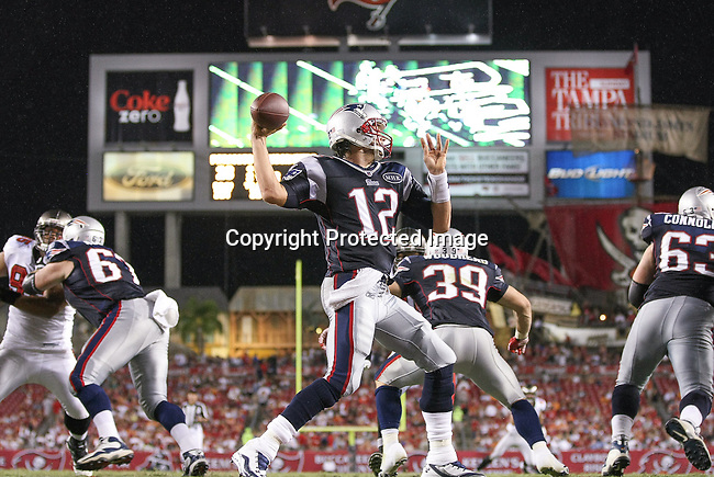 New England Patriots quarterback Tom Brady (12) throws from deep in Patriot territory against the Tampa Bay Buccaneers.  The Patriots defeated the Buccaneers 31-14 in an NFL preseason game Thursday, August 18, 2011 in Tampa, Fla.  (AP Photo/Margaret Bowles)