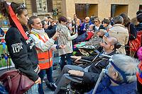 Roma 4 Novembre  2014.<br /> Manifestazione davanti al ministero dell'Economia del Comitato 16 Novembre, associazione di persone malate di Sla e loro famigliari, per chiedere il ripristino del fondo della non autosufficienza  ridotto a 250 milioni con la legge di Stabilit&agrave;, non solo torni a 350 milioni ma venga aumentato a un miliardo. Un infermiera comunica con un ammalato di Sla con la Tavola di Comunicazione.<br /> Rome November 4, 2014. <br /> Demonstration in front of the Ministry of Economy Committee November 16, an association of people sick  with ALS and their families, to ask for the restoration fund of self-sufficiency reduced to 250 million by the law of stability, not only back to 350 million but is increased one billion. A nurse  communicates with a patient with ALS with the Table of Communication