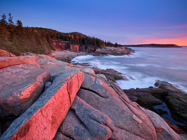 View of Monument Cove at sunrise in autumn along Ocean Drive  in Acadia National Park, Maine, USA