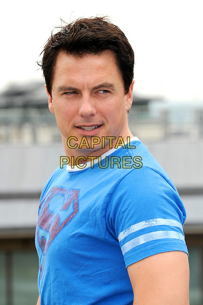 John Barrowman.Wizard Jeans Rear Of The Year Award 2012, Dorchester Hotel, London, England..June 27th, 2012.headshot portrait blue top t-shirt  .CAP/CJ.©Chris Joseph/Capital Pictures.