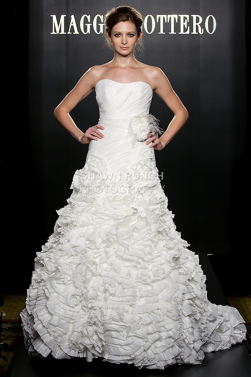 Model walks the runway in a Yolanda wedding dress from the Sottero and Midgley Spring 2012 collection, during  Couture: New York Bridal Fashion Week 2012