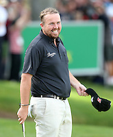 Shane Lowry makes a putt on 18 to secure 2nd place - PGA European Tour Golf at Wentworth, Surrey 25/05/14 - MANDATORY CREDIT: Rob Newell/TGSPHOTO - Self billing applies where appropriate - 0845 094 6026 - contact@tgsphoto.co.uk - NO UNPAID USE