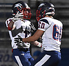 Daniel Striano #17 of Cold Spring Harbor, left, gets congratulated by Chris Romanoff #60 after rushing on a fourth down for a 32-yard touchdown in the second quarter of the Nassau County football Conference IV final against Seaford at Shuart Stadium in Hempstead on Friday, Nov. 16, 2018.