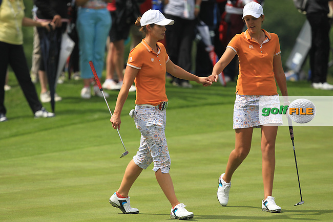 Maria Dunne and Meghan MacLaren on the 15th green during the Saturday Mourning Fourbsomes of the 2016 Curtis Cup at Dun Laoghaire Golf Club on Saturday 11th June 2016.<br /> Picture:  Golffile | Thos Caffrey