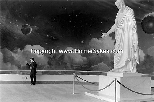 Salt Lake City Utah USA 1969. In the Mormon temple a guide waves goodbye to his group.  .