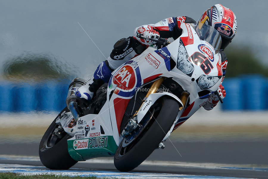 Jonathan Rea (GBR) riding the Honda CBR1000RR (65) of the Pata Honda World Superbike Team exits turn 6 during a qualifying session on day one of round one of the 2013 FIM World Superbike Championship at Phillip Island, Australia.