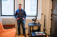 John Paul Moran is a Trump supporter who will be traveling to Washington DC to attend the inauguration and associated events as Donald Trump is sworn in as president of the United States. Moran is seen here in his live/work studio in Boston, Massachusetts.