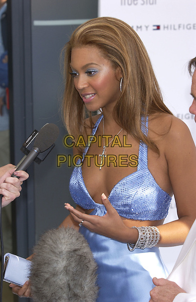 "BEYONCE KNOWLES.at launch of new Tommy Hilfiger fragrance ""True Star"" inspired by Beyonce.half length cross crucifix, blue eyeshadow, make-up, bra top, interview, microphone.www.capitalpictures.com.sales@capitalpictures.com.©Capital Pictures"
