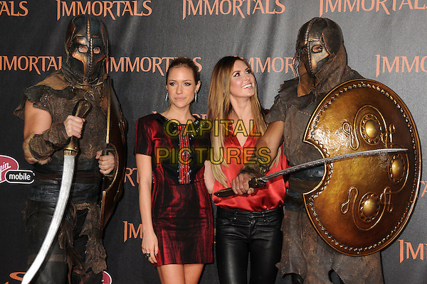 Kristin Cavallari and Audrina Patridge.The World Premiere of 'Immortals' held at The Nokia Theater Live in Los Angeles, California, USA..November 7th, 2011.half length red black silk satin blouse dress leather trousers armour armor costume shield warrior sword looking up.CAP/ADM/BP.©Byron Purvis/AdMedia/Capital Pictures.