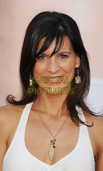 """Perrey Reeves.The Los Angeles premiere of """"The Change-Up"""" at Regency Village Theatre in Westwood, California, USA..August 1st, 2011.headshot portrait white gold earrings necklace.CAP/ROT/TM.©Tony Michaels/Roth Stock/Capital Pictures"""