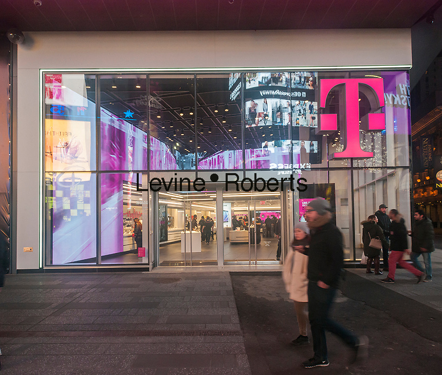 A spanking brand new T-Mobile mobile phone store opens in Times Square in New York, seen on Tuesday, March 1, 2016. (© Richard B. Levine)