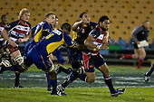 Samisoni Fisilau is caught by the Otago defenders. Air New Zealand Cup rugby game played at Mt Smart Stadium, Auckland, between Counties Manukau Steelers & Otago on Thursday August 21st 2008..Otago won 22 - 8 after leading 12 - 8 at halftime.