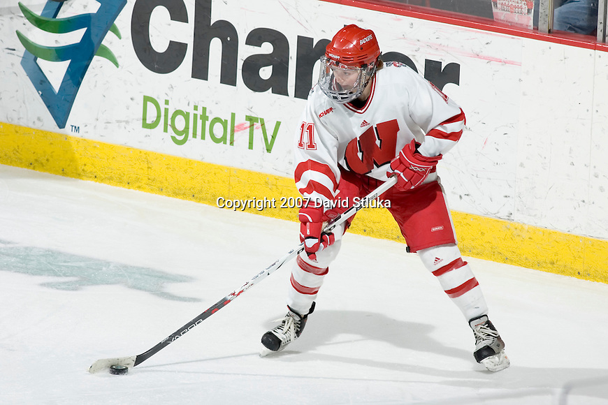 MADISON, WI - FEBRUARY 16: Kyla Sanders #11 of the Wisconsin Badgers women's hockey team handles the puck against the Bemidji State Beavers at the Kohl Center on February 16, 2007 in Madison, Wisconsin. The Badgers beat the Beavers 2-0. (Photo by David Stluka)