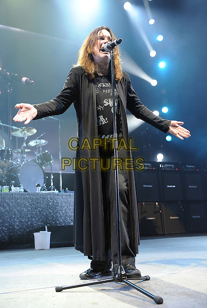 OZZY OSBOURNE .performs at Madison Square Garden as his 2010 Scream Tour makes a stop, New York, New York, USA, .1st December 2010..music live on stage gig concert full length black microphone t-shirt cardigan trousers long  singing hands .CAP/ADM/MOO.© Moose/AdMedia/Capital Pictures.