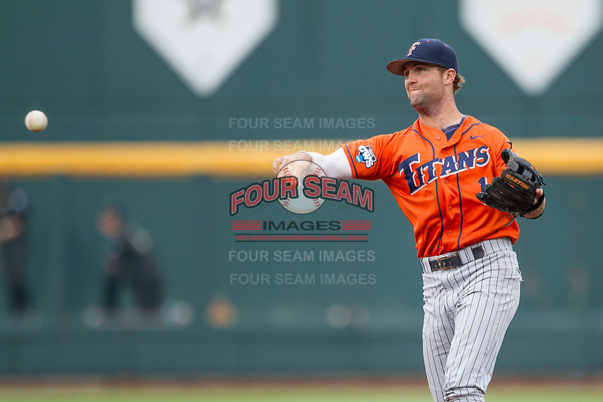 Cal State Fullerton Titans second baseman Taylor Bryant (1) makes a throw to first base during the NCAA College baseball World Series against the Vanderbilt Commodores on June 14, 2015 at TD Ameritrade Park in Omaha, Nebraska. The Titans were leading 3-0 in the bottom of the sixth inning when the game was suspended by rain. (Andrew Woolley/Four Seam Images)