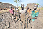 Men who form mud into blocks that will be fired into bricks outside Minyori, a small village in Central Equatoria State in Southern Sudan. NOTE: In July 2011, Southern Sudan became the independent country of South Sudan