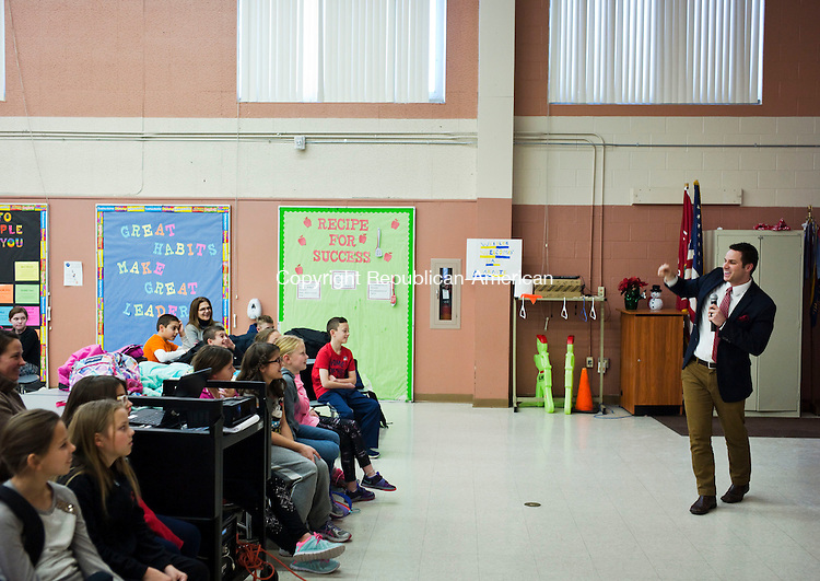 Wolcott, CT- 13 January 2016-011316CM02-  Dan Amarante, a meteorologist for Fox 61 speaks to fourth and fifth grade students at Wakelee School in Wolcott on Wednesday.  Amarante presented slide shows with various weather photographs, talked about his line of work and answered questions from the children.  Christopher Massa Republican-American