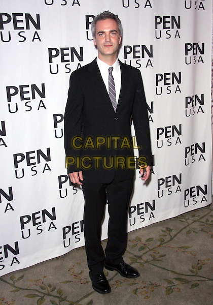 Guest .20TH Annual Literary Awards Festival held at the Beverly Hills Hotel, Beverly Hills, CA, USA, .17th November 2010..full length black suit white shirt tie .CAP/ADM/TC.©T. Conrad/AdMedia/Capital Pictures.