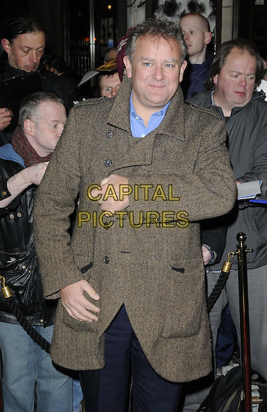 "Hugh Bonneville.The ""Macbeth"" press night performance, Trafalgar Studios, Whitehall, London, England..February 22nd, 2013.half length beige brown coat jacket hand arm.CAP/CAN.©Can Nguyen/Capital Pictures."