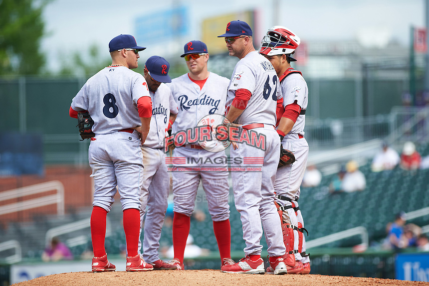 Reading Fightin Phils manager Dusty Wathan (62) makes a pitching change as Carlos Alonso (8), Jesmuel Valentin (2), Rhys Hoskins (12) and catcher Jorge Alfaro (11) look on during a game against the New Hampshire Fisher Cats on May 30, 2016 at Northeast Delta Dental Stadium in Manchester, New Hampshire.  New Hampshire defeated Reading 9-1.  (Mike Janes/Four Seam Images)