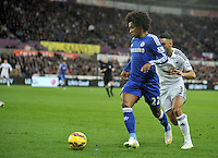 SWANSEA, WALES - JANUARY 17:   of  during the Barclays Premier League match between Swansea City and Chelsea at Liberty Stadium on January 17, 2015 in Swansea, Wales.<br /> <br /> Chelsea's Willian under pressure from Neil Taylor