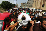 Mourners carry the body of Palestinian Nasser Shurrab,18, who was shot dead by Israeli troops during clashes at Gaza-Israel border, during his funeral in Khan Younis in the southern Gaza Strip July 14, 2018. Photo by Ashraf Amra