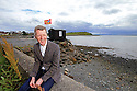 TRAVEL PIECE TO GO WITH GLENN PATTERSON COUNTY DOWN - Glenn Patterson sits near the Kircubbin Car Wash on the Portaferry Road,  County Down, Northern Ireland.  Photo/Paul McErlane