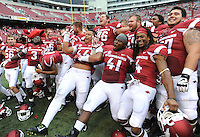 NWA Media/ANDY SHUPE - Arkansas players celebrate after the Hogs' 73-7 win over Nicholls Saturday, Sept. 6, 2014, at Razorback Stadium in Fayetteville